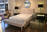 Bed with an exclusive quilted headboard